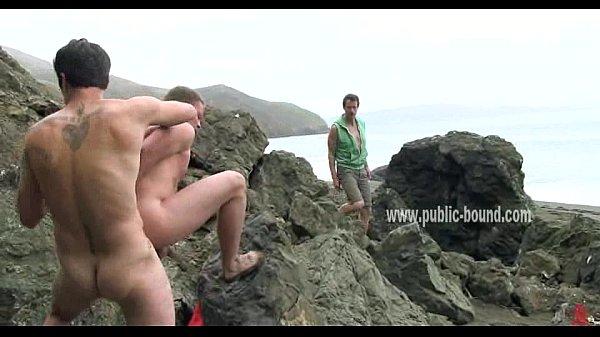 Gay boys on a beach enjoy fuckin their bitch in rough outdoor gangbang sex video